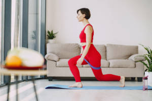 Canva Sportswoman doing stretching exercise on mat