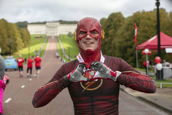 Runners descend on Stormont for Northern Ireland Chest Heart and Stroke's Red Dress Run
